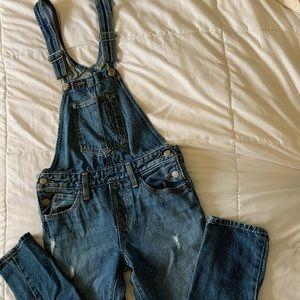 Lightly distressed Levi's denim overalls